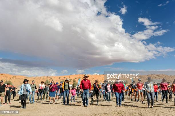 A crowd gathers to line dance at the Big Red Bash 2017 on July 6 2017 in Birdsville Australia