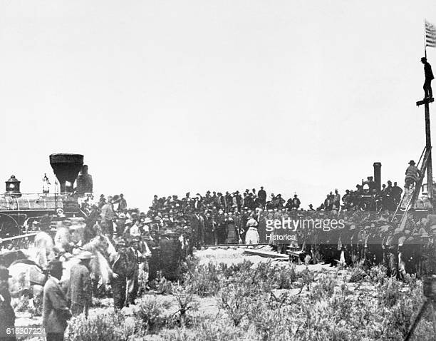 A crowd gathers to see the joining of the tracks for the first transcontinental railroad in Promontory Utah Territory in 1869