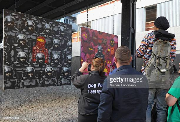 A crowd gathers to view Banksy's latest work October 18 2013 in the Chelsea neighborhood of New York City The British street artist Banksy has been...