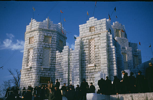 A crowd gathers to walk through the Ice Palace made from blocks of ice during the StPaul Winter Carnival in StPaulMinnesota