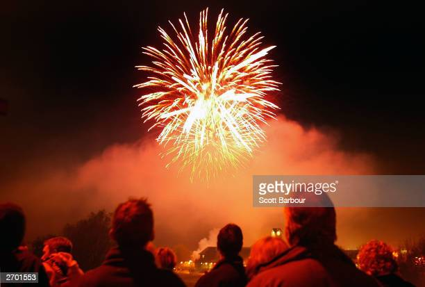 A crowd gathers to watch a fireworks display during Bonfire Night celebrations November 5 2003 in Lewes England The celebration marks the day of the...