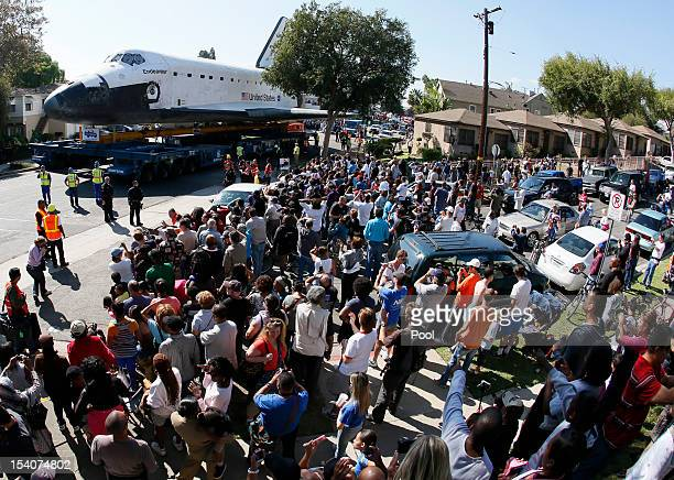 A crowd gathers to watch as the Space Shuttle Endeavour is moved to the California Science Center on October 13 2012 in Inglewood California The...
