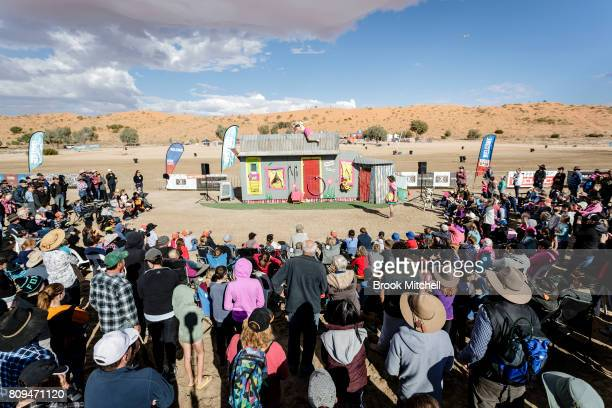 A crowd gathers to watch the CrackUp Sisters perform on the final day of the The Birdsville Big Red Bash 2017 on July 6 2017 in Birdsville Australia