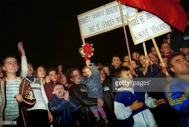A crowd greets Kosovar human rights activist Flora Brovina as she crosses the boundary from Serbia to Kosovo November 1 2000 after her release from a...