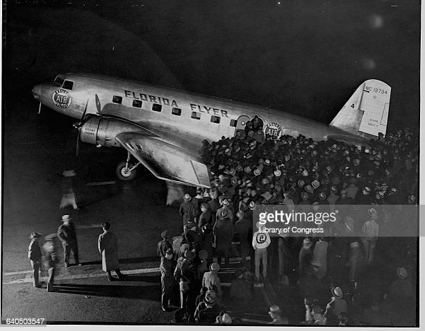 A crowd greets passengers arriving at the Newark Airport via the Florida Flyer aircraft