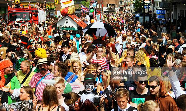 Crowd in carnival parade in the streets of Aalborg, Denmark