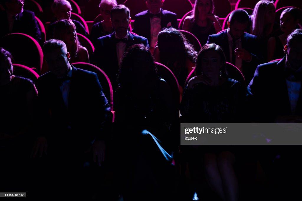 Crowd in dark watching opera in theater : Stock Photo