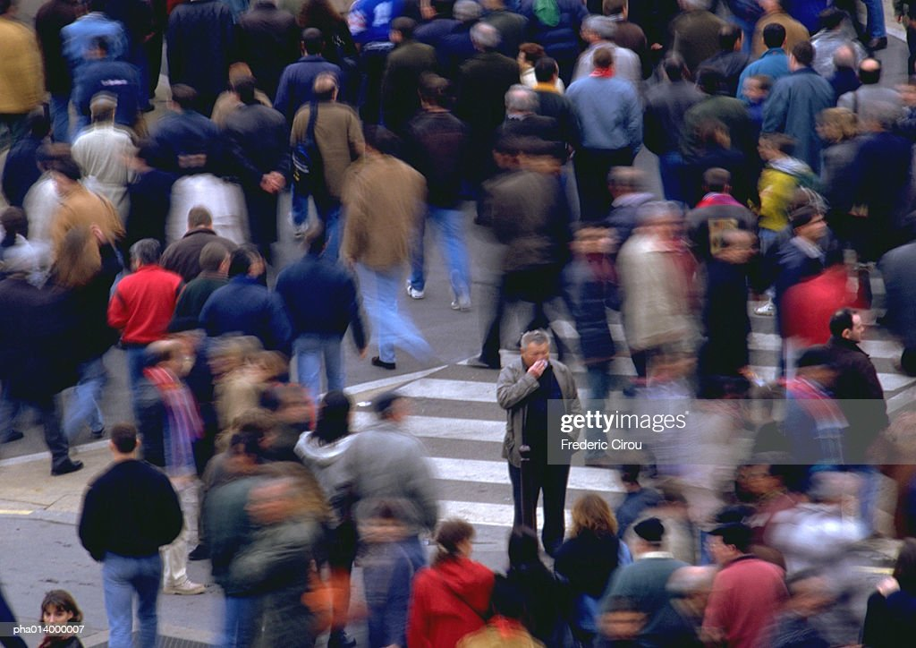 Crowd in distance, blurred. : Stock Photo