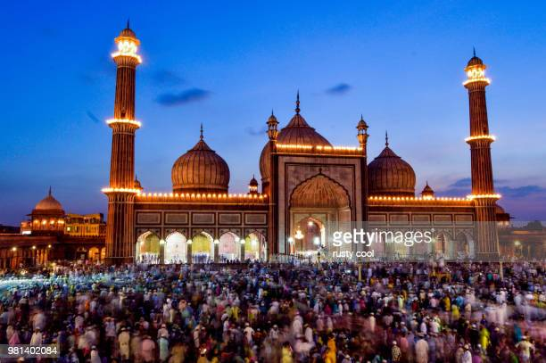 crowd in front of jama masjid, delhi, india - jama masjid delhi stock pictures, royalty-free photos & images