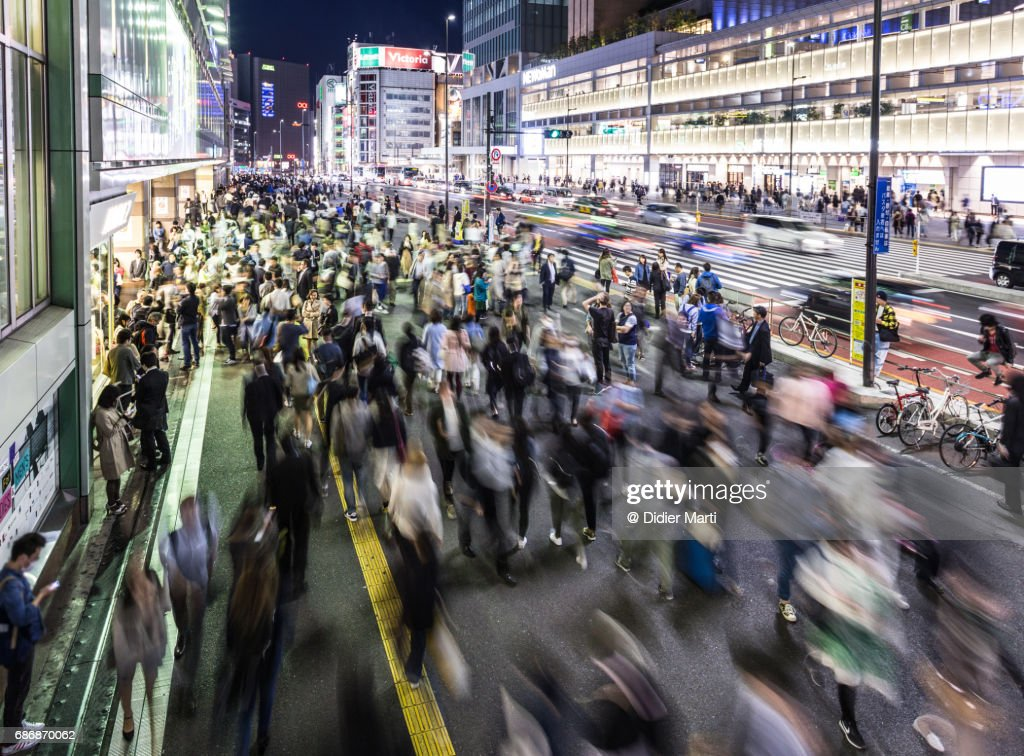 Crowd in front of the busy Shinjuku station in Tokyo : Stock Photo
