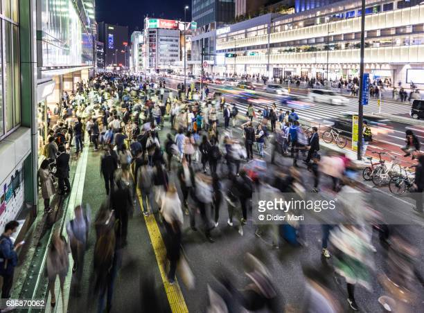 crowd in front of the busy shinjuku station in tokyo - japan commuters ストックフォトと画像