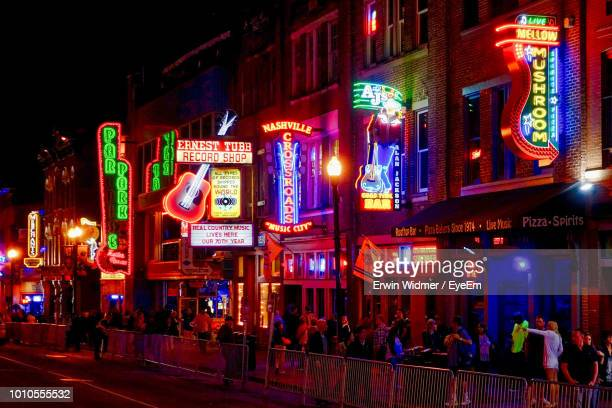 crowd in illuminated city at night - tennessee stock pictures, royalty-free photos & images