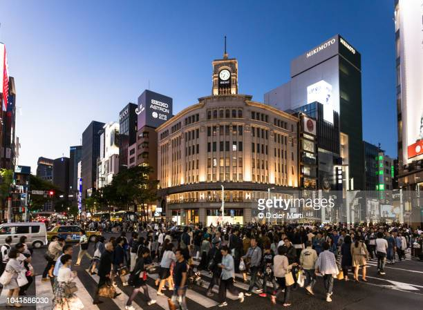 crowd in in the streets of ginza in tokyo, japan - ginza stock pictures, royalty-free photos & images