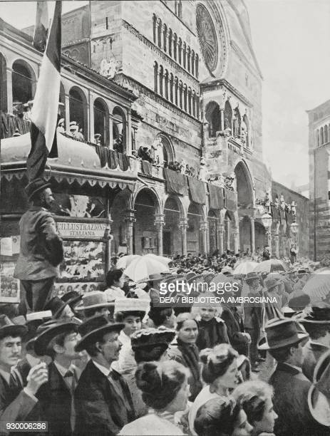 Crowd in the town square for Vittorio Emanuele III's arrival with the Cathedral of St Mary of the Assumption in the background Cremona Italy...