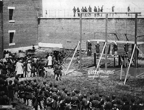 Crowd in the yard of Washington DC's Old Penitentiary, watching the hanging of Mrs Surratt and John Wilkes Booth's conspirators in the plot to kill...