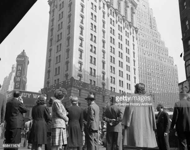 Crowd in Times Square on DDay Low Angle View New York City New York USA Howard R Hollem for Office of War Information June 6 1944
