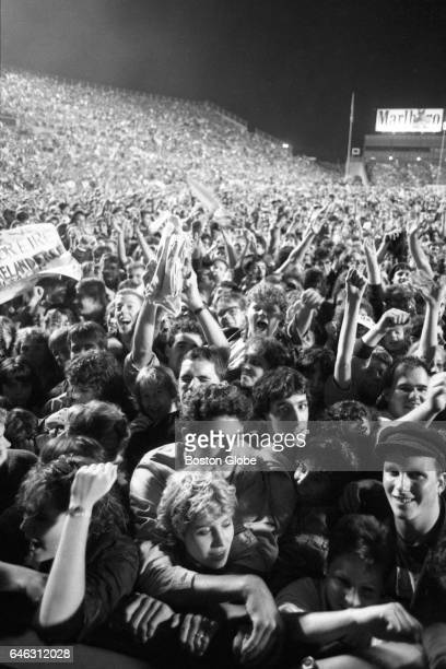 """Crowd is gathered for U2's performance at Sullivan Stadium on their tour supporting """"The Joshua Tree"""" in Foxborough, MA on Sep. 22, 1987."""