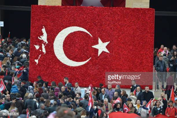 Crowd is seen around a board in the shape of a Turkish flag at Anitkabir the Mausoleum of modern Turkey's founder and first president Mustafa Kemal...
