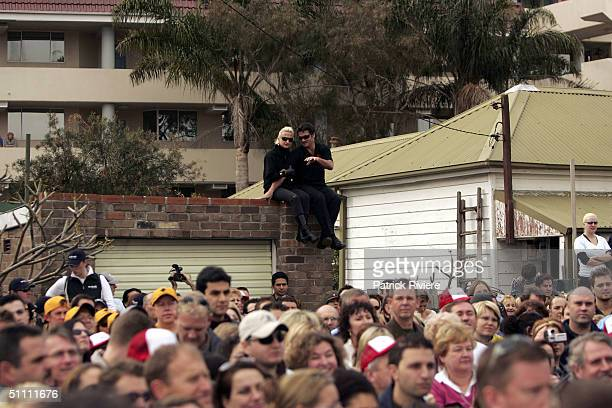 A crowd is seen during the auction of the first two units of the second series of the reality television show 'The Block' July 24 2004 in Manly...