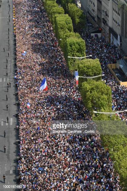 Crowd is seen on the Champs Elysees before the French Football Team Parades on the Champs Elysees after winning the World Cup 2018 on July 16 2018 at...