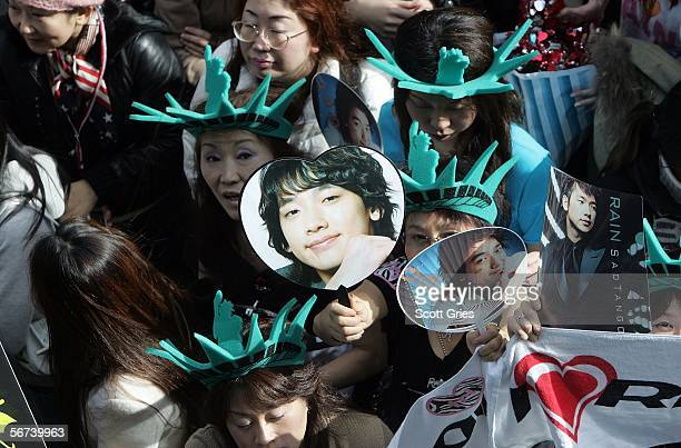 A crowd is seen outside while South Korean pop singer Rain appears onstage during a taping of MTV World Presents Rain Live in New York at the MTV...