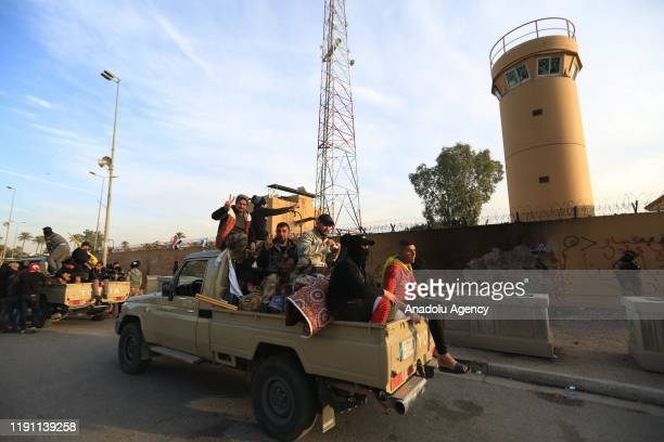 Crowd leave the site after Iranianbacked Hashd alShaabi group urges its members to withdraw from around US Embassy in Baghdad Iraq on January 01 2020...