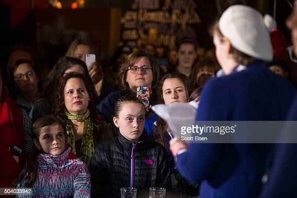A crowd listens as screenwriter and actress Lena Dunham speaks at a Hillary Clinton for President event on January 8 2016 in Manchester New Hampshire...
