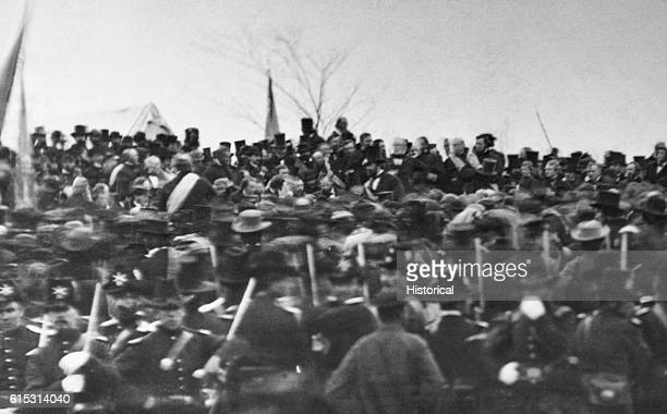 A crowd listens to President Abraham Lincoln giving his famous Gettysburg Address a speech given at the dedication of the Civil War cemetery in...