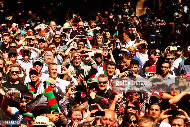 Crowd looks on during a South Sydney Rabbitohs NRL Grand Final celebration at Sydney Town Hall on October 9 2014 in Sydney Australia