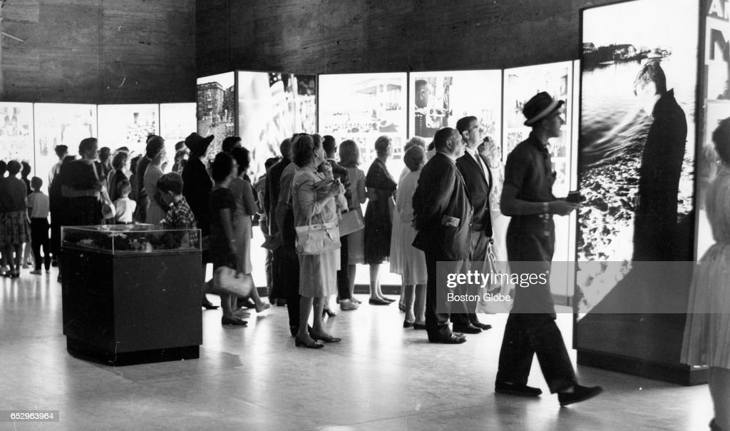 A crowd looks over the traveling John F. Kennedy Library Exhibit at the Museum of Fine Arts in Boston on Aug. 19, 1964.