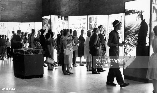 A crowd looks over the traveling John F Kennedy Library Exhibit at the Museum of Fine Arts in Boston on Aug 19 1964