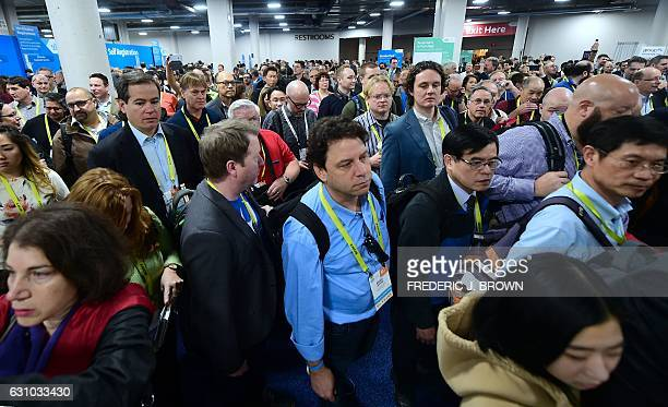 A crowd makes their way through the showroom floor at the 2017 Consumer Electronics Show in Las Vegas Nevada on January 5 2017 / AFP / Frederic J...