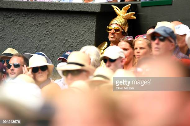 A crowd member is dressed up as The Gentlemen's Singles Trophy on centre court on day seven of the Wimbledon Lawn Tennis Championships at All England...