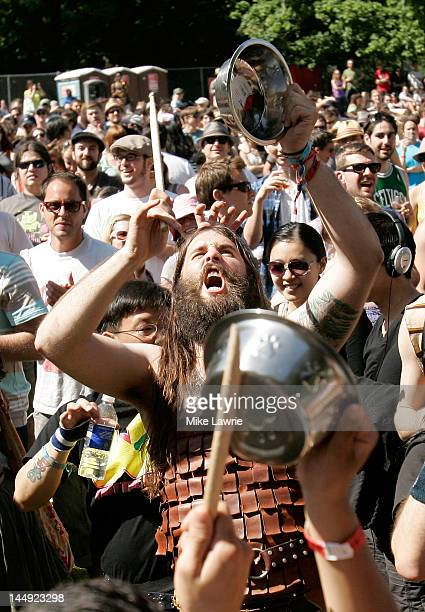 A crowd member plays a dog bowl as PeelanderZ performs at the Great Googa Mooga 2012 at Prospect Park on May 20 2012 in the Brooklyn borough of New...
