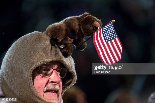 Crowd member wears a Groundhog day themed headwear before ceremonies for Groundhog Day on February 2 2018 in Punxsutawney Pennsylvania Punxsutawney...