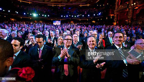 Crowd members applaud the National Anthem as Republican presidential candidates Ohio Governor John Kasich businesswoman Carly Fiorina Florida Sen...