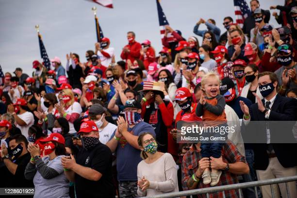 Crowd members cheer toward cameras before the arrival of President Donald Trump to a Make America Great Again rally on September 19, 2020 in...