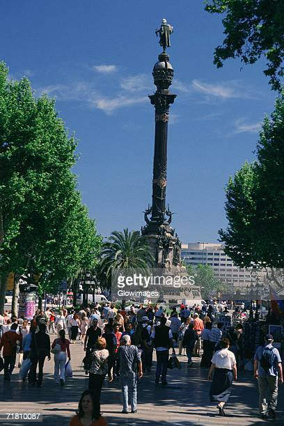 crowd near a monument, columbus monument, barcelona, catalonia, spain - the ramblas stock pictures, royalty-free photos & images