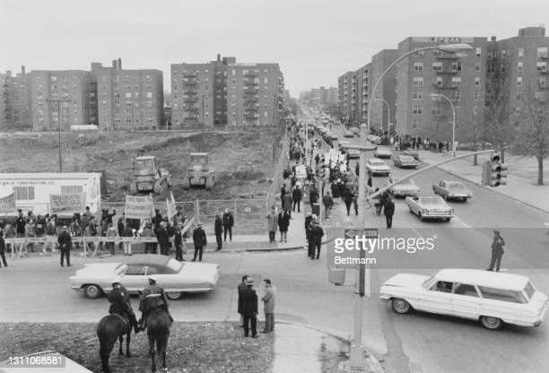 Crowd of 2,500 residents of the Forest Hills neighbourhood of Queens stage a protest at plans to build a low-income housing development in their...