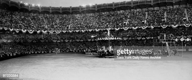 A crowd of 52448 filled Yankee Stadium for international bout between Golden Gloves champions and Italian national team on June 9 1937 The Italian...