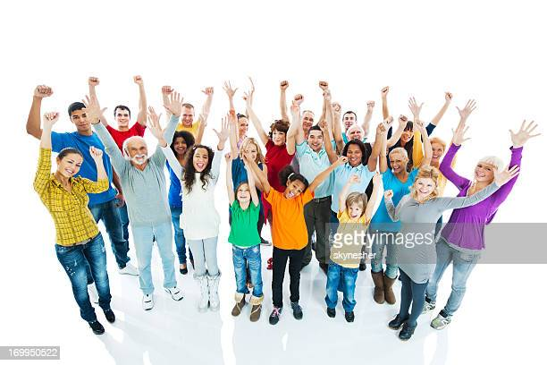 Crowd of a people with arms raised.
