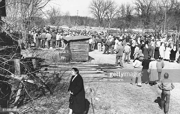 Crowd of about 2,000 persons took advantage of sunny skies to watch the auction on March 30, 1958 of the Ed Gein farm. The highest bidder for the...