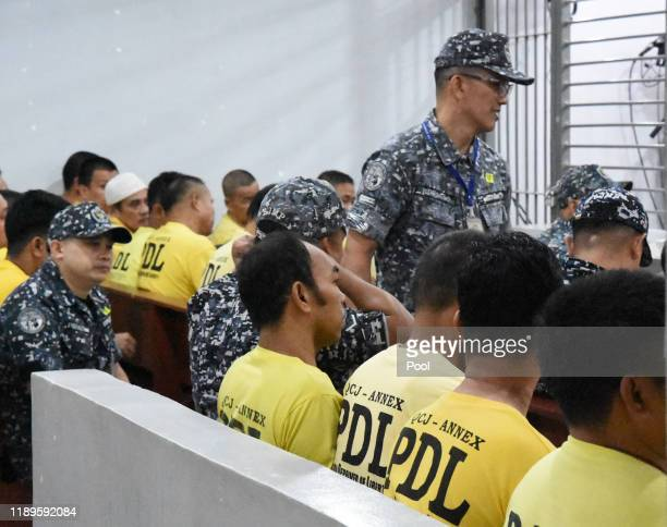 A crowd of accused in the Maguindanao massacre wait for the promulgation at the trial venue inside a prison facility on December 19 2019 in Manila...
