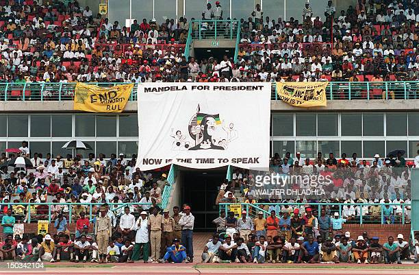 A crowd of African National Congress supporters listen to the address of ANC President Nelson Mandela during a mass rally in Rustenburg 30 January...