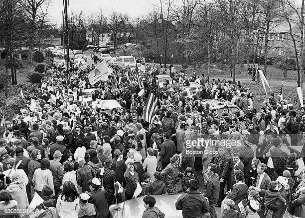 A crowd of antibusing demonstrators stand in front of 1974 United Way Chairman William Mercer's home in Wellesley Mass on April 13 1975 After the...