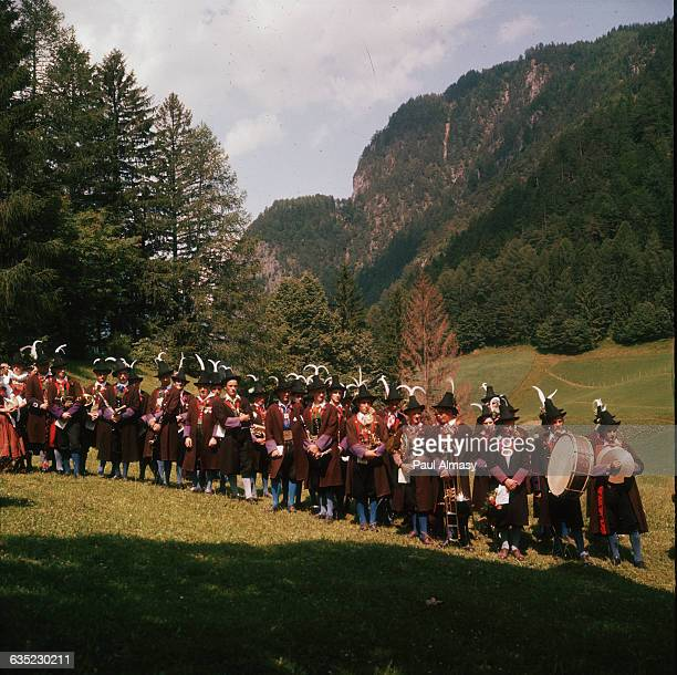 A crowd of Austrian men in traditional costumes in the Tyrol region of Austria