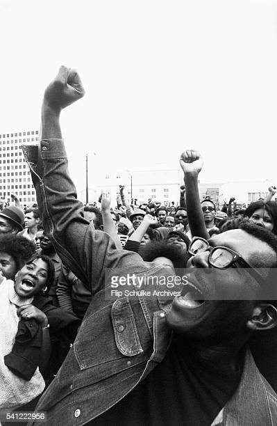 Crowd of black activists give the Black Power salute at a rally for the Black Panther Party.