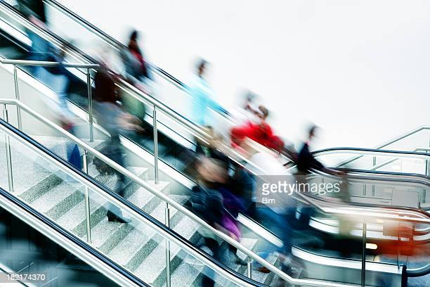 Crowd of Blurred People on Stairs and Escalator