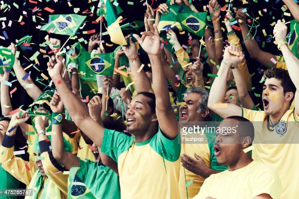 Crowd of Brazilian fans cheering