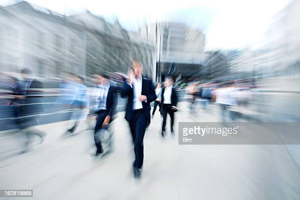 Crowd of Business People, Businessman Using Mobile Phone, Blurred Motion